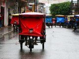 Mototaxis with Protective Rain Covers
