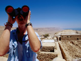 Man with Binoculars at an Archeological Dig