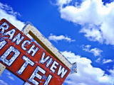 Weather-Beaten Sign of Roadside Hotel