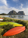 Canoes and Kayaks Lining Lagoon Beach with Mt Gower and Mt Lidgbird in Distance