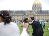Wedding Couple Kissing with Les Invalides in Background