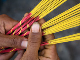 Close-Up of Woman's Hands Holding Incense Sticks
