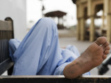 Man Resting on Park Bench in Bur Dubai