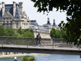 Cyclist on Passerelle Leopold Sangor