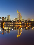 Skyline and Bridge Reflected in Main River at Dusk