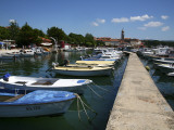 Boats in Harbour Beside Obala Hrvatske Mornarice Promenade with Tower of Krk Cathedral Beyond