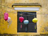 Lanterns Hanging Besides Bright Yellow Wall
