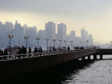 People on the Esplanade  and a View of Hong Kong Island Shrouded in a Twilight Mis