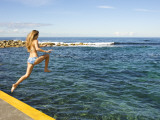 Girl Jumping into Sea at Clovelly Bay