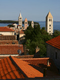 Historic Centre of Rab Town with Rooftops and Four Bell Towers