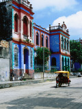 Brightly Coloured Buildings and Motorcycle Taxi