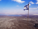 The Blue and White Flag of Israel  the Star of David Flies over the Deserts of Masad