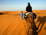 Traveller Riding Camel at Erg Chebbi