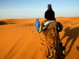 Traveller Riding Camel at Erg Chebbi