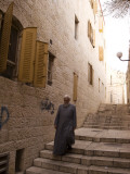 Man Walking Down Stairs in Old Jerusalem