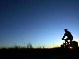 Man Cycle Touring at Dawn