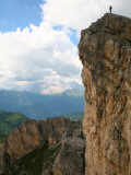 Hiker Standing on Top of Cliff Near Averau Peak in Dolomites Range Near Cortina