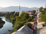 People on Kujundziluk in Old Town  Koski Mehmed Pasa Mosque and Neretva River