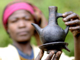 Dorze Woman with Black Coffee Pot