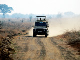 Safari Vehicle Kicking Up Dust