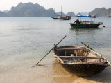 Woven Sampan Beached on Sand with Halong Bay and Boats in Background