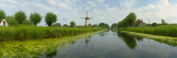 Traditional Windmill Along With a Canal  Damme  Belgium