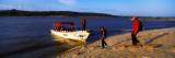 Tourists With a Boat at The Riverside  Orinoco  Ciudad Bolivar  Bolivar State  Venezuela