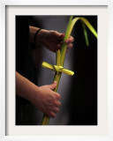 Person Holds a Palm Frond Bended into Shape of Cross During Palm Sunday Mass at Cathedral in Havana