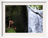 Child from the Ache Indigenous Group Plays Near a Waterfall in Cerro Moroti  Paraguay