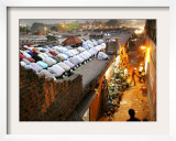 Indian Muslims During Friday Evening Prayers on the Rooftop of a Building over an Auto Parts Market
