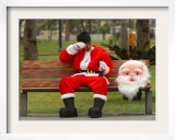 Ronald Guzman  Who Works as Santa Claus  Takes a Break in a Public Park in Lima  Peru