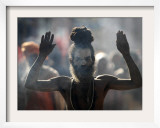 Naked Hindu Holy Man Performs Rituals on Banks of River Ganges During the Kumbh Mela in India