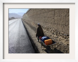Child Uses a Wheel Barrow to Carry Jugs of Water  Logar Province  Afghanistan