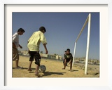 Iraqi Boys Play Soccer in a Baghdad Neighborhood