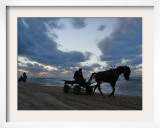 Palestinians Ride on Horse-Drawn Carts Along the Beach South of Gaza City