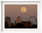A Full Moon Rises Behind Downtown Saint Louis Buildings and the Gateway Arch Friday