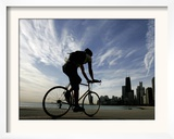 A Lone Cyclists Pedals Along Lake Michigan