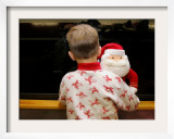 Six-Year-Old Boy Looks out the Window for Santa Claus