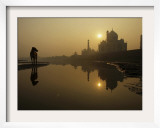 Stray Dog on a Sand Bank of the Yamuna River as the Sun is Seen Rising over the Taj Mahal in India