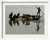 Fishermen Cast their Nets in the River Ganges on the Outskirts of Allahabad  India