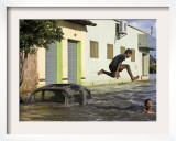 Children Play in a Flooded Street in Trizidela Do Vale  Maranhao State  Brazil