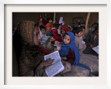 Afghan Refugee Children Holding Copies of the Quran  Repeat after their Teacher