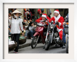 Vietnamese Men Dressed as Santa Claus Wait on their Motorbikes on a Street in Hanoi  Vietnam
