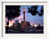 Traffic Passes by the Angel of Independence Monument in the Heart of Mexico City
