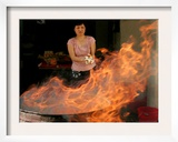 A Woman Prepares to Burn Hell Money