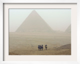 Tourists Ride Camels Through a Dust Storm at the Site of the Great Pyramids