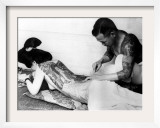 An Unidentified Japanese Tattoo Artist Works on a Woman&#39;s Backside