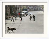 Children Play Soccer on a Deserted Street of Katmandu  Nepal
