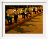 Young Guineans Study under the Dim Parking Lot Lights at G'Bessi Airport in Conakry  Guinea