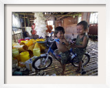 Children Play with a Bicycle Inside a Chicken Shed at Bobokan Tempel Village